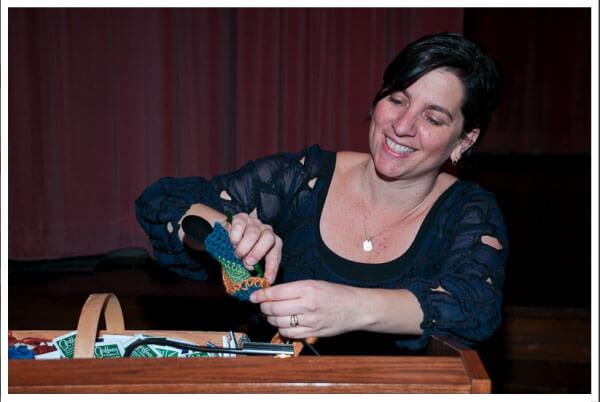 Miss Melissa yarn bombing Mayor Nutter's microphone.