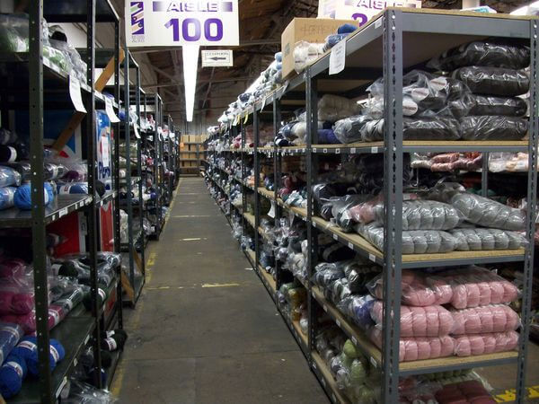 We buy our yarn for summer camp and after school classes at yarn warehouses like this one.