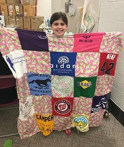 Camper holding memory quilt-674506-edited