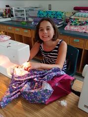 Girl working with sewing machine, The Handwork Studio
