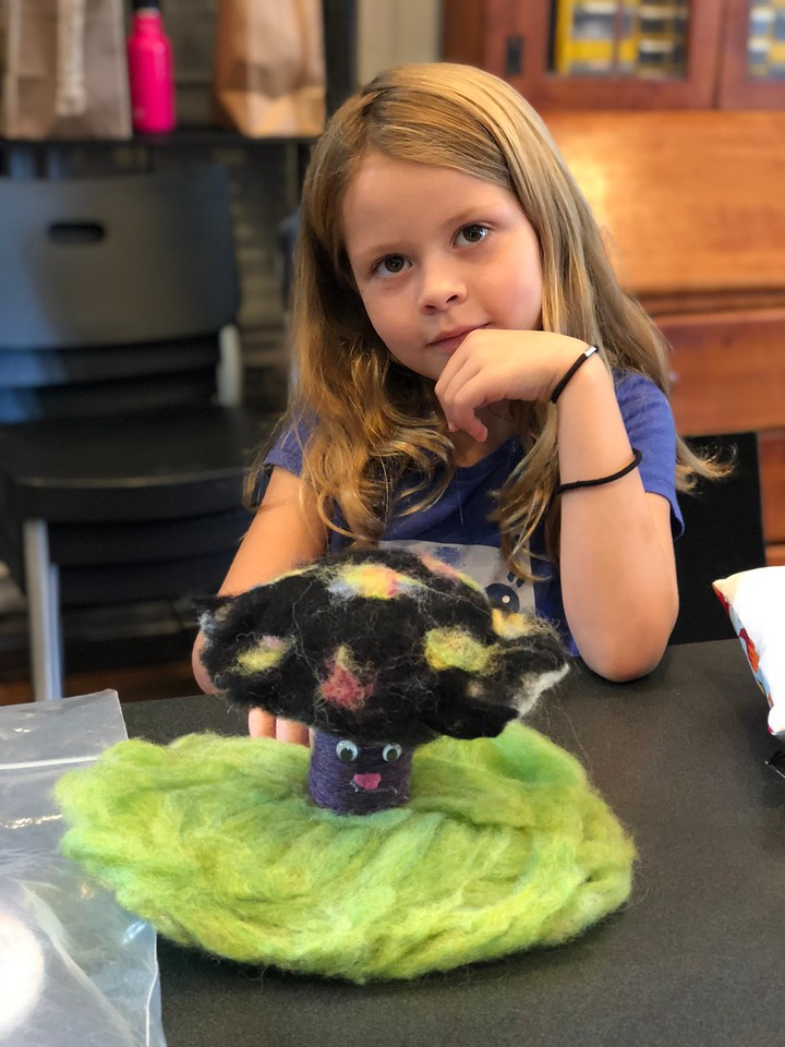 Kid with wet felted creation, Narberth Handwork Camp