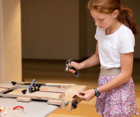 girls - learning - woodworking - skills